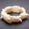 Браслет на резинке Черепахи слоновая кость