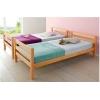 Односпальная кровать из натурального дерева.